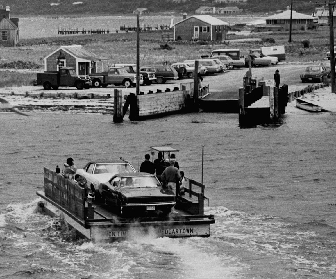 """The two car ferry """"On Time"""" carrying tourists approaches slip on Chappaquiddick Island on trip from Edgartown on Martha's Vineyard on July 25, 1969. Sen. Edward M. Kennedy was headed for this ferry landing late on July 18, when he took a wrong turn and plunged off a bridge and passenger Miss Mary Jo Kopechne, 28, of Washington, D.C., was killed. The Building at left is waiting room for ferry. (Photo: AP)"""