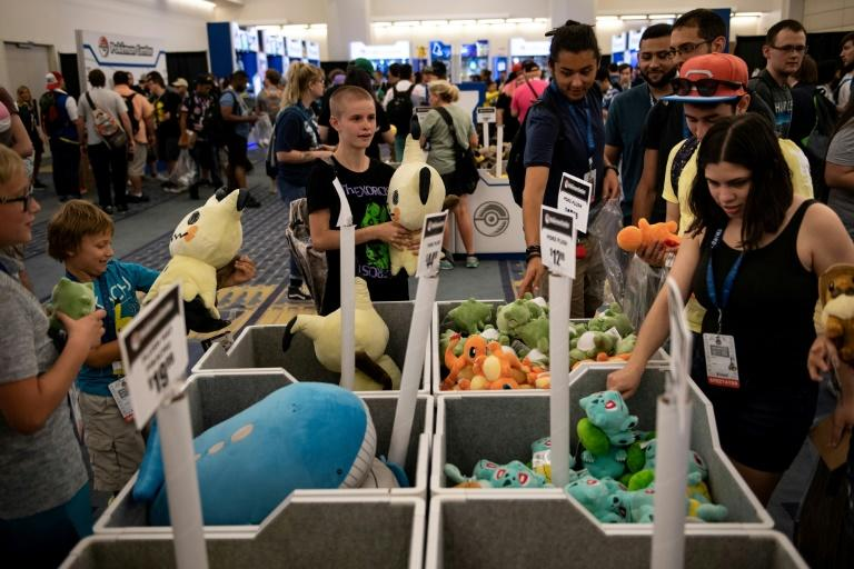 People peruse Pokemon products during the first day of the 2019 Pokemon World Championships in Washington