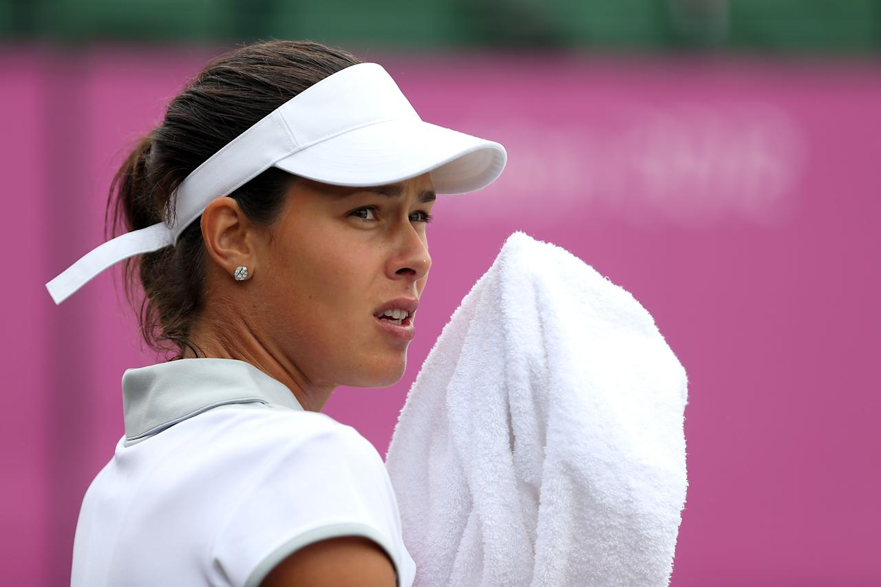 LONDON, ENGLAND - AUGUST 01:  Ana Ivanovic of Serbia looks on against Kim Clijsters of Belgium on Day 5 of the London 2012 Olympic Games at Wimbledon on August 1, 2012 in London, England.  (Photo by Clive Brunskill/Getty Images)