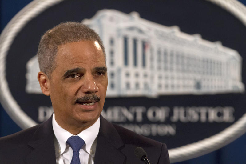 Attorney General Eric Holder speaks at the Justice Department in Washington, Tuesday, Feb. 5, 2013. The U.S. government accused Standard & Poor's of inflating ratings on mortgage investments to boost its bottom line, taking aim at a key player in the run-up to the financial crisis.  (AP Photo/Jacquelyn Martin)