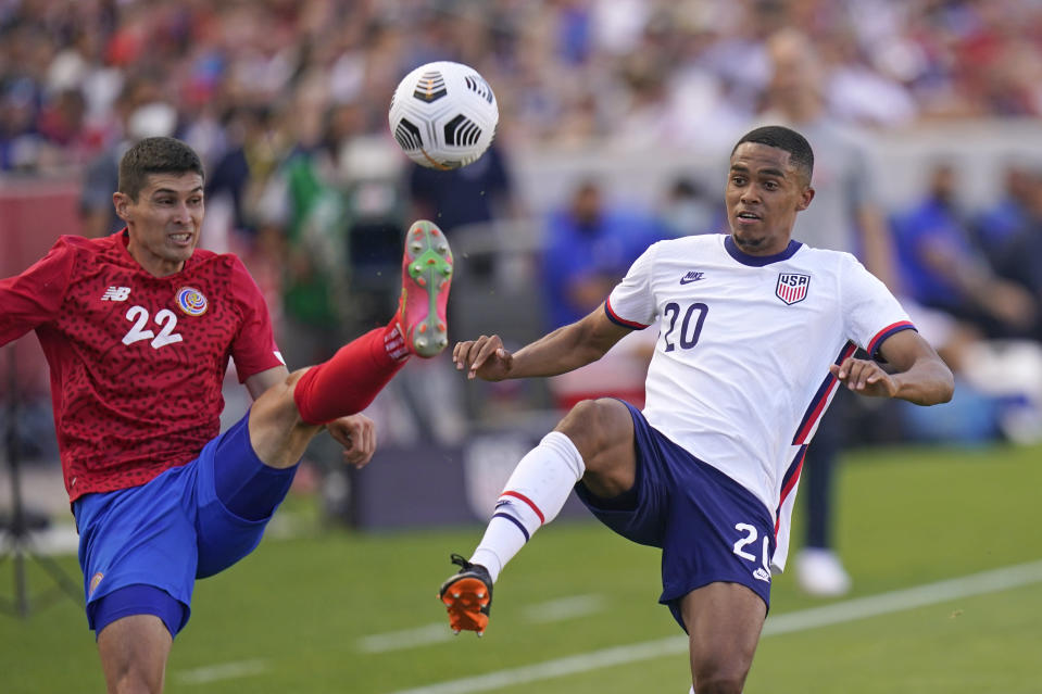 United States' Reggie Cannon (20) and Costa Rica's Ronald Matarrita (22) vie for the ball during the second half during an international friendly soccer match Wednesday, June 9, 2021, in Sandy, Utah. (AP Photo/Rick Bowmer)