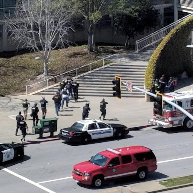<p>Law enforcement officials react following a possible shooting at the headquarters of YouTube in San Bruno,Calif. on April 3, 2018. (Photo: Graeme Macdonald/Via Reuters) </p>