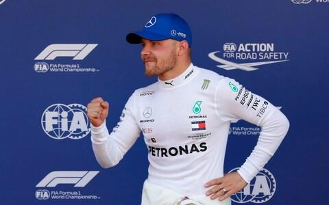 Mercedes driver Valtteri Bottas of Finland celebrates after setting the pole position during the qualifying session at the Barcelona Catalunya racetrack in Montmelo, just outside Barcelona, Spain, Saturday, May 11, 2019. The Formula One race will take place on Sunday - Credit: AP