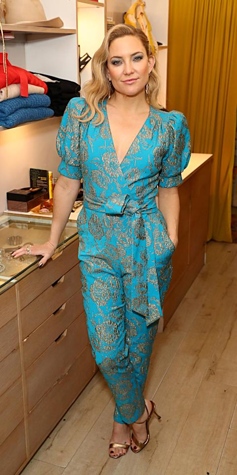 <p>Kate Hudson wore a gold flower embroidered HappyxNature jumpsuit to a holiday celebration hosted by the brand.</p>