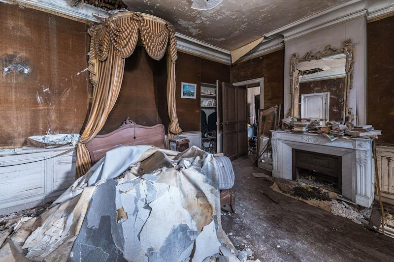 Many of the once noble site's ceilings have fallen, water damage is rife among the attic and the floors littered with rubbish, unwanted belonging and debris.(Photo: Bob Thissen/Caters News)