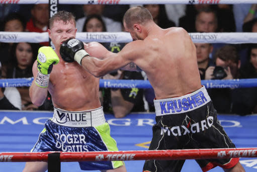 Sergey Kovalev, right, lands a punch against Canelo Alvarez during a light heavyweight WBO title bout, Saturday, Nov. 2, 2019, in Las Vegas (AP Photo/Isaac Brekken)