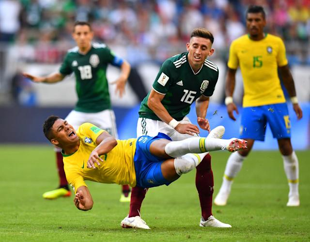 <p>Brazil's Casemiro in action with Mexico's Hector Herrera REUTERS/Dylan Martinez </p>