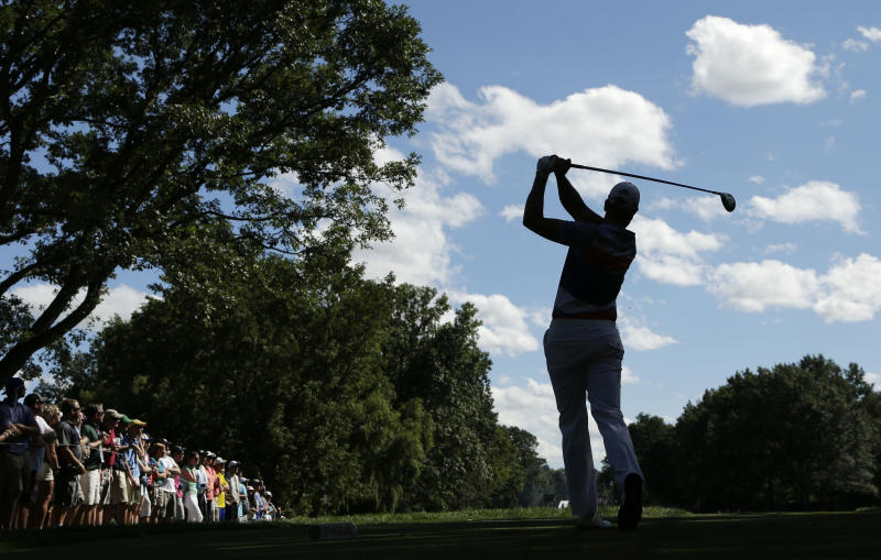 Henrik Stenson, of Sweden, watches his tee shot on the eighth hole during the third round of the PGA Championship golf tournament at Oak Hill Country Club, Saturday, Aug. 10, 2013, in Pittsford, N.Y. (AP Photo/Charlie Riedel)