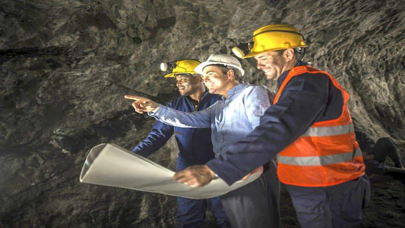 Miners working at the mine with an engineer