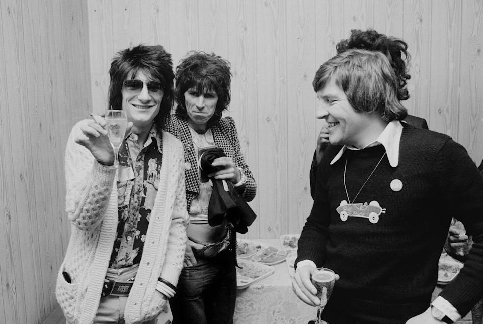<p>Ron Wood (left) of rock group Faces, and Keith Richards of the Rolling Stones (second from left), at a reception for producer Phil Spector, October 4, 1974.</p>
