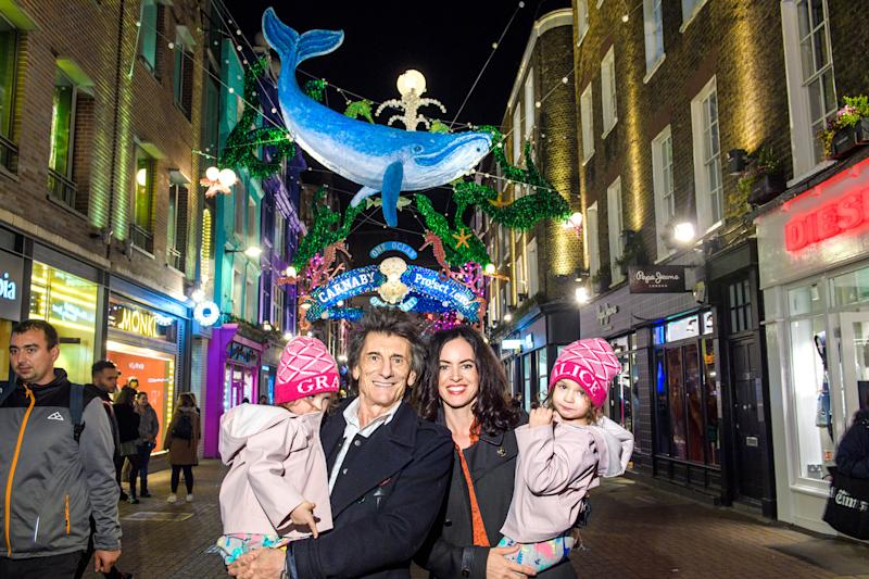 EDITORIAL USE ONLY Ronnie Wood, his wife Sally and their children Gracie and Alice, attend the switch on of the new sustainable, ocean-themed Christmas light installation in Carnaby London, created in partnership with ocean conservation charity Project Zero.