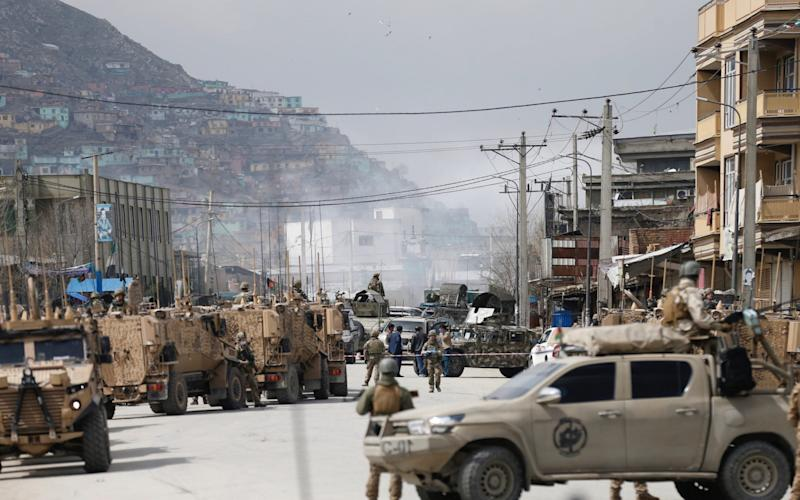 Afghan security forces inspect near the site of an attack in Kabul, Afghanistan March 25, 2020.REUTERS/Mohammad Ismail - Reuters