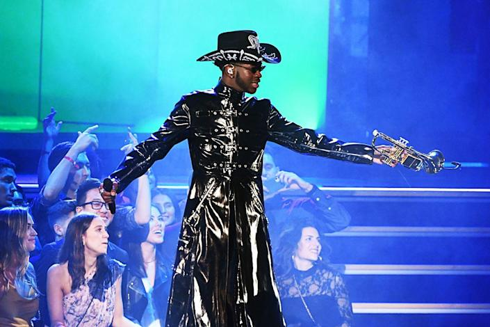 <p>For his performance on stage at the event, he went for a <em>Matrix</em>-inspired patent leather trench and an embroidered hat. </p>
