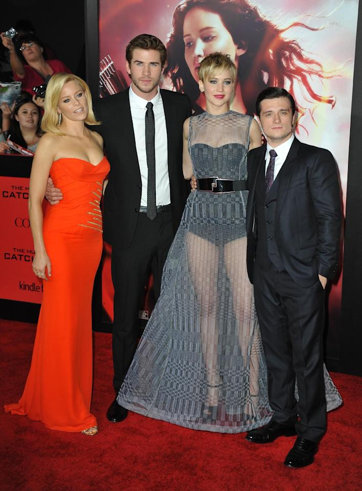 """From left, Elizabeth Banks, Liam Hemsworth, Jennifer Lawrence and Josh Hutcherson arrive at the Los Angeles premiere of """"The Hunger Games: Catching Fire"""" at Nokia Theatre LA Live on Monday, Nov. 18, 2013. (Photo by Jordan Strauss/Invision/AP)"""