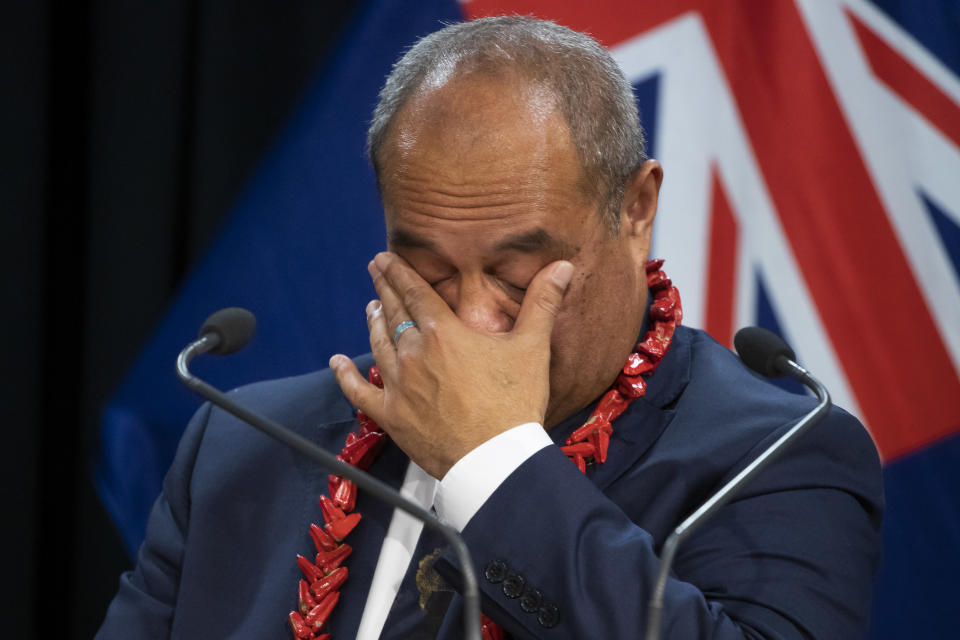 Pacific Peoples Minister Aupito William Sio reacts while talking about his personal experiences of the 1970's dawn raids during a post-Cabinet press conference at Parliament in Wellington, New Zealand, Monday, June 14, 2021. New Zealand's government is formally apologizing for an immigration crackdown nearly 50 years ago in which Pacific people were targeted for deportation, often after early-morning home raids. (Mark Mitchell/NZ Herald via AP)