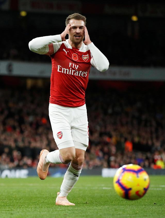 """Soccer Football - Premier League - Arsenal v Wolverhampton Wanderers - Emirates Stadium, London, Britain - November 11, 2018 Arsenal's Aaron Ramsey reacts after a missed chance Action Images via Reuters/John Sibley EDITORIAL USE ONLY. No use with unauthorized audio, video, data, fixture lists, club/league logos or """"live"""" services. Online in-match use limited to 75 images, no video emulation. No use in betting, games or single club/league/player publications. Please contact your account representative for further details."""