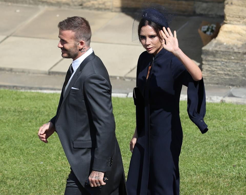 David and Victoria Beckham arrive at St George's Chapel in Windsor Castle for the wedding of Prince Harry and Meghan Markle.   Saturday May 19, 2018.  Andrew Milligan/Pool via REUTERS
