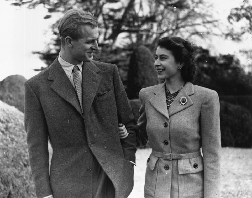 24th November 1947  Princess Elizabeth and The Prince Philip, Duke of Edinburgh enjoying a walk during their honeymoon at Broadlands, Romsey, Hampshire.  (Photo by Topical Press Agency/Getty Images)