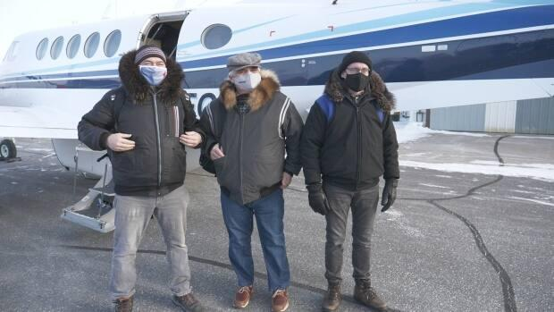 Nunavut's Premier Joe Savikataaq, left, Health Minister Lorne Kusugak, centre, and Chief Public Health Officer Dr. Michael Patterson, right, boarded a charter from Iqaluit to Arviat on Tuesday.  (David Gunn/CBC - image credit)