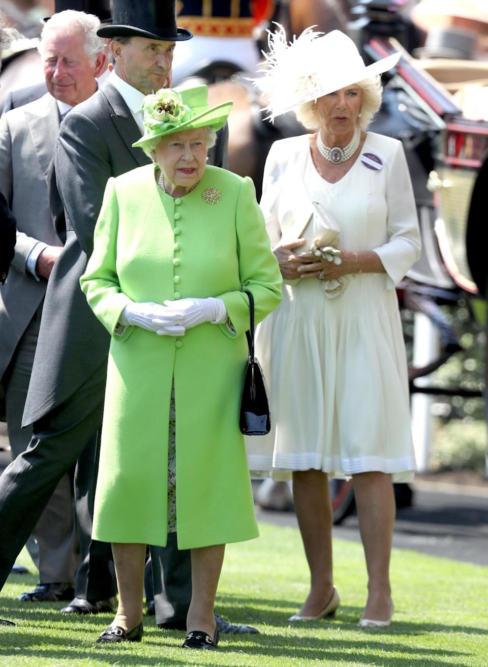 <p>Her Majesty wore a lime green coat by Stewart Parvin with a matching hat to kick off Royal Ascot 2017. <i>[Photo: Getty]</i> </p>