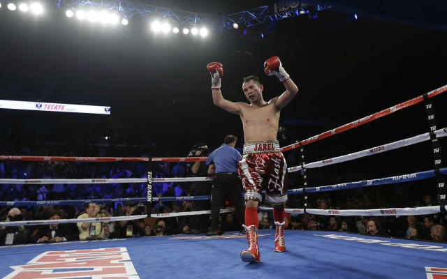 Nonito Donaire celebrates his win over Vic Darchinyan during round 9 of their featherweight rematch, Saturday, Nov. 9, 2013, in Corpus Christi, Texas. (AP Photo/Eric Gay)