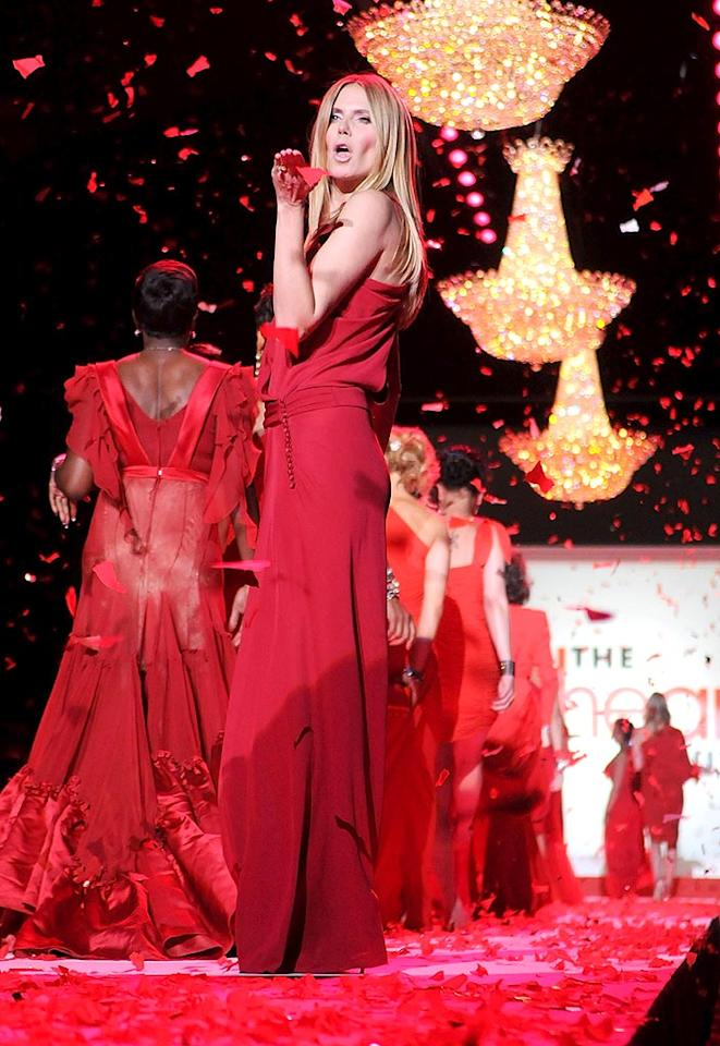"""Heidi Klum closed the show with a kiss! In keeping with the show's charity theme, a number of dresses will be up for auction in support of women's heart health awareness on <a href=""""http://clothesoffourback.org"""" target=""""new"""">clothesoffourback.org</a>. George Napolitano<a href=""""http://www.filmmagic.com/"""" target=""""new"""">FilmMagic.com</a> - February 11, 2010"""