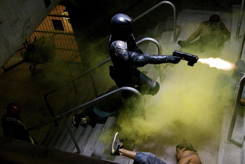 "This film image released by Lionsgate shows Karl Urban in a scene from ""Dredd 3D."" (AP Photo/Lionsgate)"
