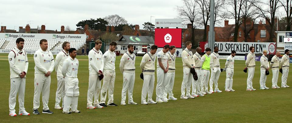 Players line up for a two minute silence to mark the announcement of the death of Prince Phillip, the Duke of Edinburgh during the County Championship match between Northamptonshire and Kent at The County Ground on April 09, 2021.
