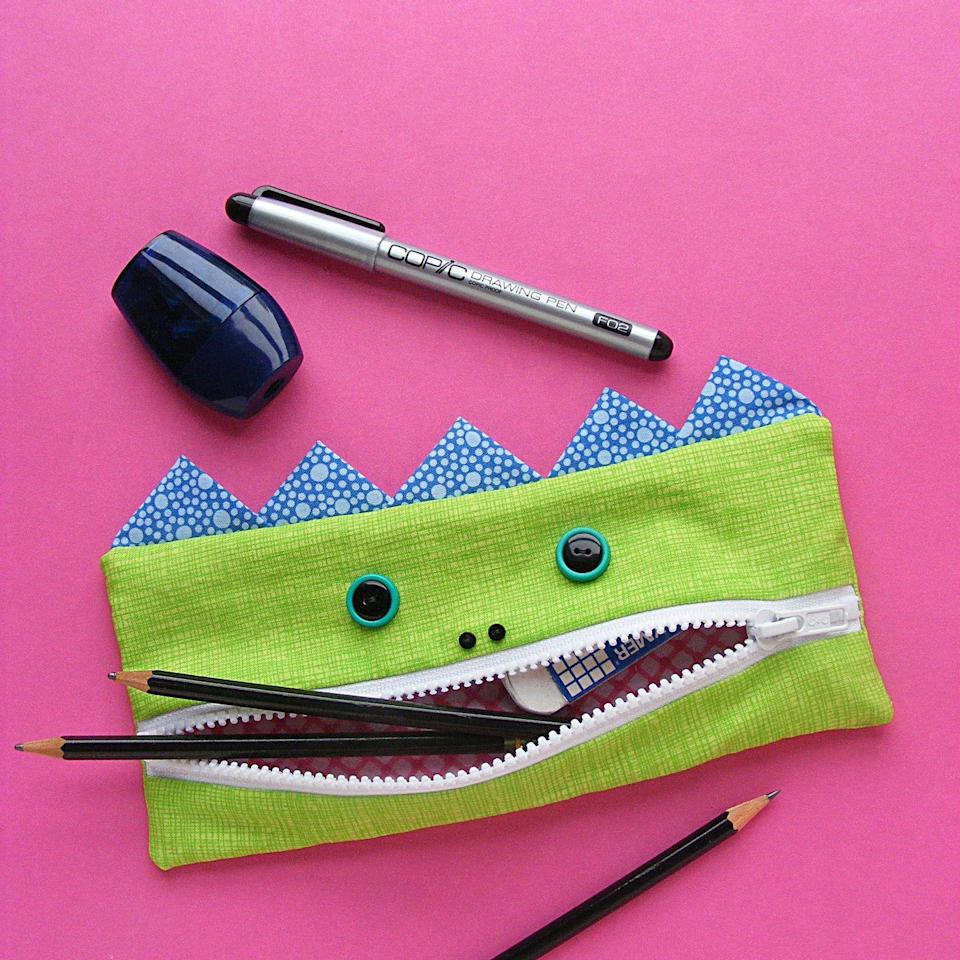 """<p>They call this """"The Gobbler"""" for a reason — it eats up school supplies. (And it keeps them neatly organized.)</p><p><em><a href=""""https://www.shinyhappyworld.com/2014/09/free-pattern-gobbler-pencil-eating-monster-back-school.html"""" rel=""""nofollow noopener"""" target=""""_blank"""" data-ylk=""""slk:Get the tutorial at Shiny Happy World »"""" class=""""link rapid-noclick-resp"""">Get the tutorial at Shiny Happy World »</a></em></p>"""