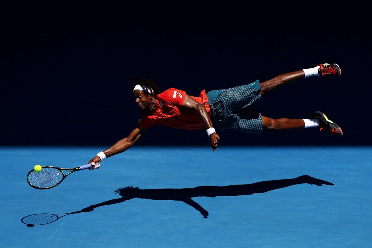 Gael Monfils of France dives for a forehand in his fourth round match against Andrey Kuznetsov of Russia, during the 2016 Australian Open at Melbourne Park, Australia, on 25 January 2016. The Australian Open holds the record for the highest attendance at a Grand Slam event. Cameron Spencer, Getty Images/Courtesy of World Press Photo Foundation/Handout via REUTERS   THIS IMAGE HAS BEEN SUPPLIED BY A THIRD PARTY. FOR EDITORIAL USE ON WORLD PRESS PHOTO ONLY. NO RESALES. NO CROPPING