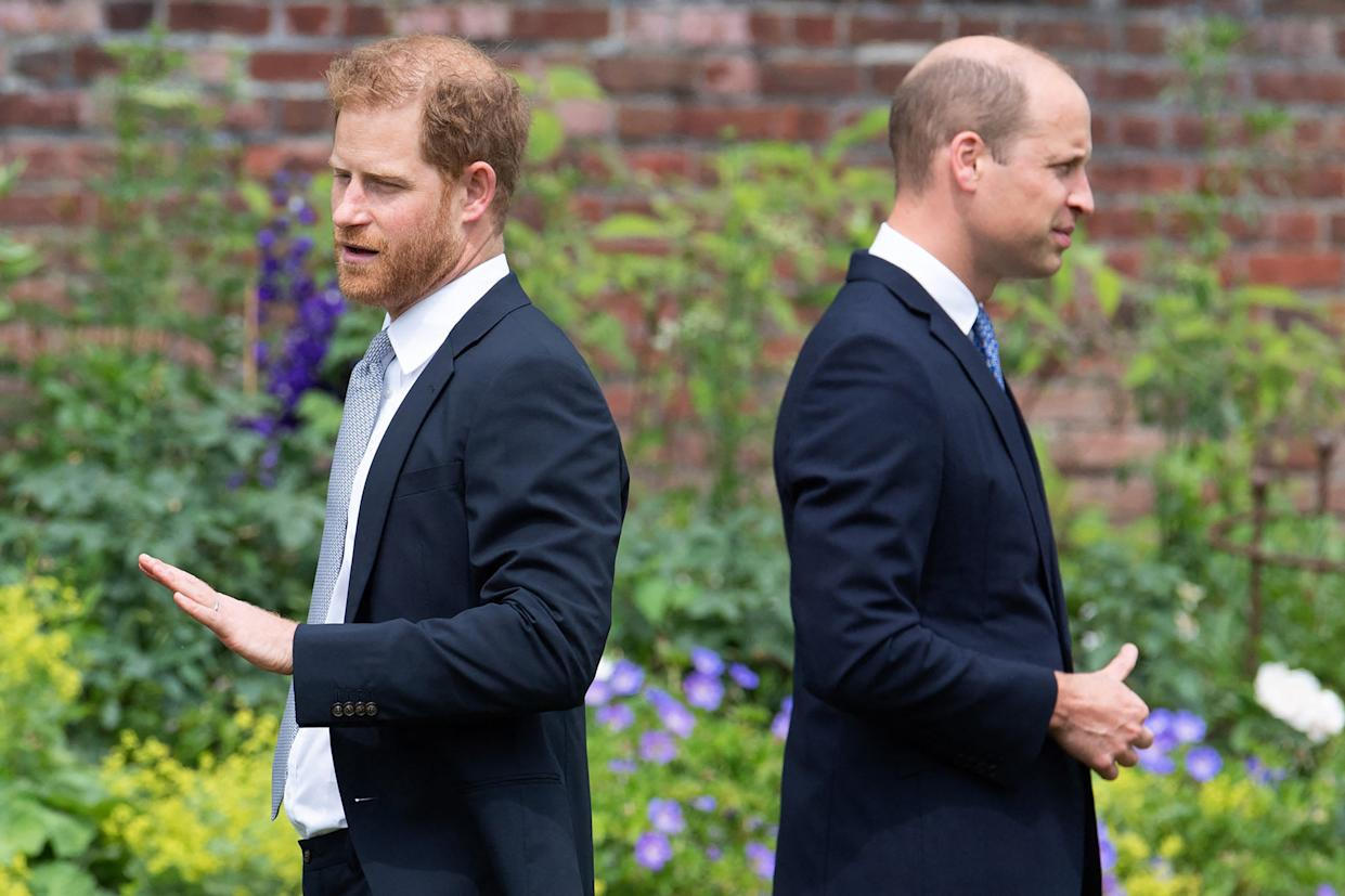 Britain's Prince Harry, Duke of Sussex (L) and Britain's Prince William, Duke of Cambridge attend the unveiling of a statue of their mother, Princess Diana at The Sunken Garden in Kensington Palace, London on July 1, 2021, which would have been her 60th birthday. - Princes William and Harry set aside their differences on Thursday to unveil a new statue of their mother, Princess Diana, on what would have been her 60th birthday. (Photo by Dominic Lipinski / POOL / AFP) (Photo by DOMINIC LIPINSKI/POOL/AFP via Getty Images)
