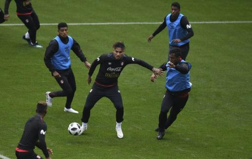 Peru's forward Paolo Guerrero (C) vies for the ball with teammates during a training session at the Arena Khimki stadium, outside Moscow, on June 11, 2018, ahead of the Russia 2018 World Cup