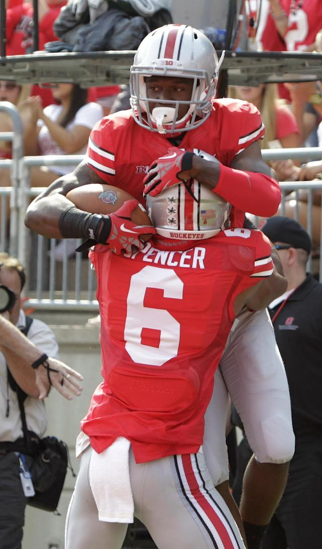 Ohio State running back Donte Wilson, top, celebrates his touchdown with teammate Evan Spencer during the first quarter of an NCAA college football game against San Diego State on Saturday, Sept. 7, 2013, in Columbus, Ohio. (AP Photo/Jay LaPrete)