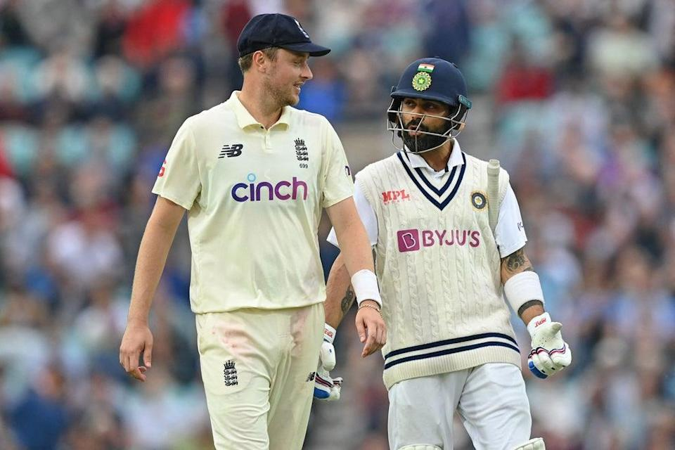 Ollie Robinson chats with Virat Kohli as players leave the field (AFP)