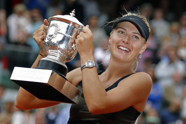 FILE - In this Saturday June 9, 2012 file photo, Maria Sharapova of Russia holds the trophy after winning the women's final match against Sara Errani of Italy at the French Open tennis tournament in Roland Garros stadium in Paris. Two-time French Open champion Maria Sharapova has pulled out of the years second Grand Slam tournament because of her injured right shoulder. Sharapova announced her withdrawal on Instagram, on Tuesday, May 14, 2019. (AP Photo/Michel Euler, File)