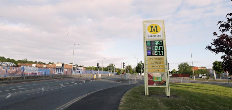 A Morrisons supermarket sign selling unleaded petrol at 99.7p per litre at its store in Belle Vale, Liverpool, after the chain reduced its prices across its UK forecourts.