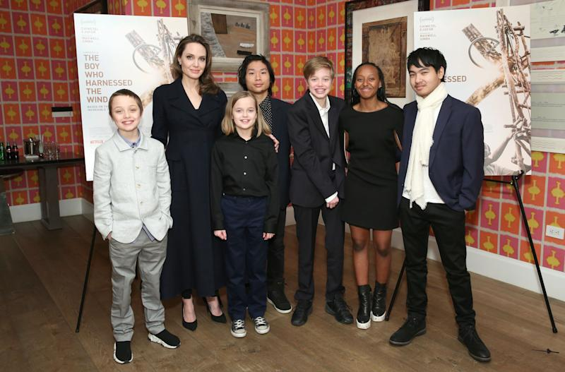 Angelina Jolie depicted with her children Knox, Vivienne, Pax, Shiloh, Zahara and Maddox. (Photo: Monica Schipper/Getty Images for Netflix)
