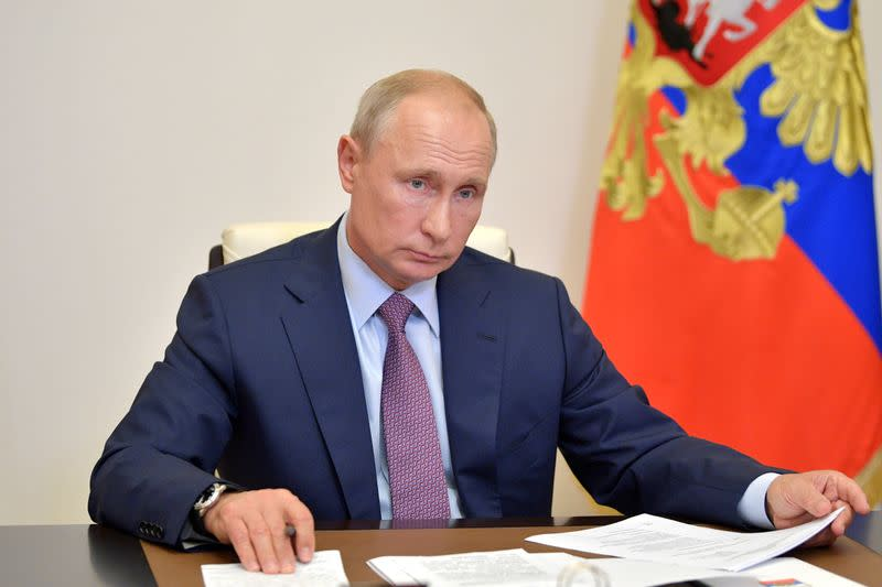 Russian President Putin takes part in a video conference call outside Moscow