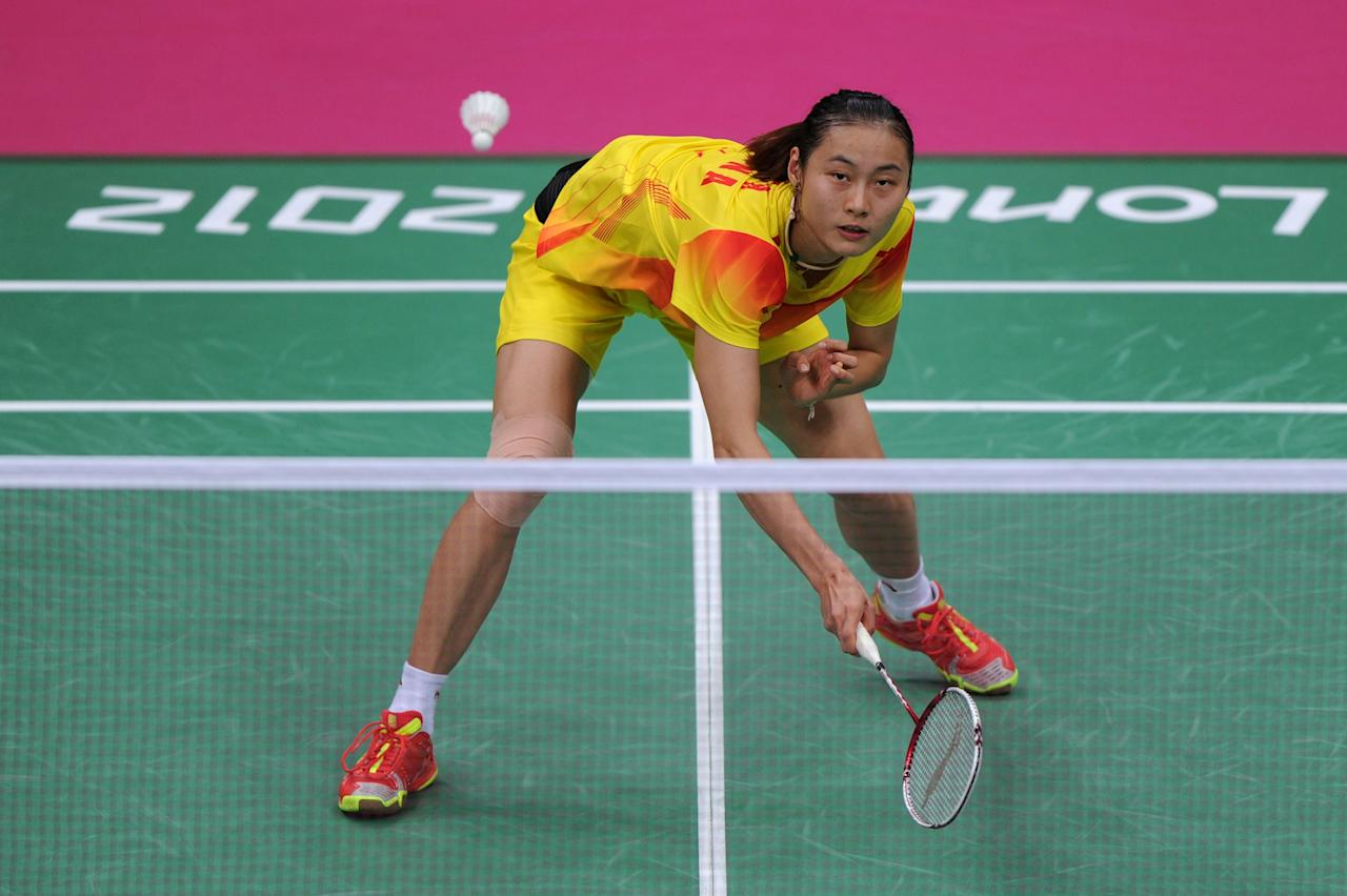 LONDON, ENGLAND - AUGUST 03: Yihan Wang of China in action in the Women's Singles Badminton Singles Semi-Final against Saina Nehwal of India on Day 7 of the London 2012 Olympic Games at Wembley Arena on August 3, 2012 in London, England.  (Photo by Michael Regan/Getty Images)