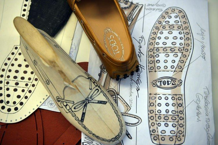 Drawings of moccasin prototypes are displayed at the Tod's workshop in Casette d'Ete, May 27, 2013