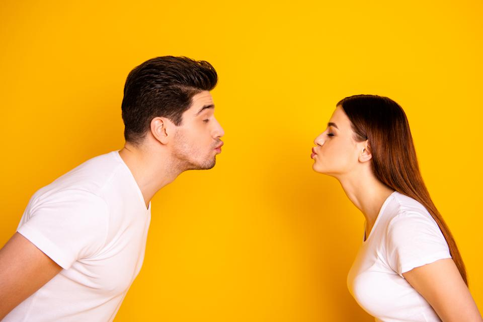 Close up side profile photo amazing beautiful she her he him his guy lady bonding ahead each other need kisses tenderness spread lips wear casual white t-shirts outfit isolated yellow background.