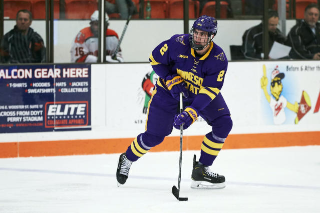 FILE - In this Dec. 15, 2018, file photo, Minnesota State defenseman Connor Mackey (2) skates with the puck against the Bowling Green during an NCAA college hockey game in Bowling Green, Ohio. Mackey, a top college free agent, signed with the Calgary Flames last week. (AP Photo/Rick Osentoski, File)