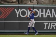 Texas Rangers center fielder Leody Taveras (3) catches a fly ball hit by Los Angeles Angels' Jack Mayfield during the sixth inning of a baseball game Friday, Sep. 3, 2021, in Anaheim, Calif. (AP Photo/Ashley Landis)