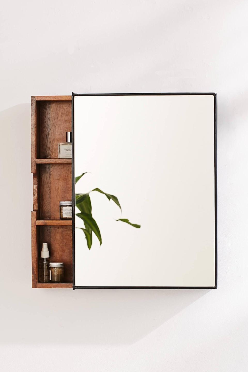 "<p>Store your favorite products in this <a href=""https://www.popsugar.com/buy/Plymouth-Sliding-Storage-Mirror-551627?p_name=Plymouth%20Sliding%20Storage%20Mirror&retailer=urbanoutfitters.com&pid=551627&price=99&evar1=casa%3Aus&evar9=47251564&evar98=https%3A%2F%2Fwww.popsugar.com%2Fhome%2Fphoto-gallery%2F47251564%2Fimage%2F47252505%2FPlymouth-Sliding-Storage-Mirror&list1=cleaning%2Corganization%2Cspring%20cleaning%2Csmall%20space%20living%2Cbathrooms%2Chome%20organization&prop13=mobile&pdata=1"" class=""link rapid-noclick-resp"" rel=""nofollow noopener"" target=""_blank"" data-ylk=""slk:Plymouth Sliding Storage Mirror"">Plymouth Sliding Storage Mirror</a> ($99, originally $149).</p>"