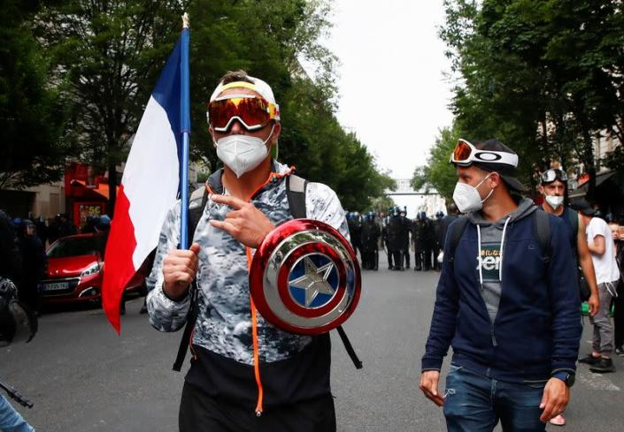 Protest against measures announced by French President Macron to fight the COVID-19 outbreak, in Paris