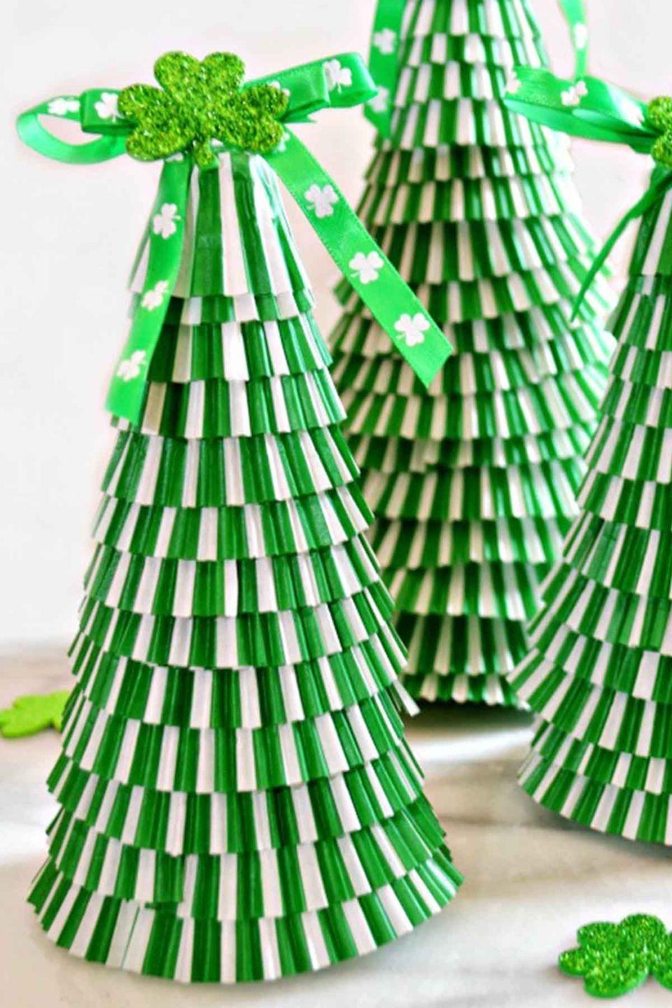 """<p>Paper trees are a common <a href=""""https://www.womansday.com/home/crafts-projects/how-to/g299/decorative-holiday-crafts-100780/"""" rel=""""nofollow noopener"""" target=""""_blank"""" data-ylk=""""slk:Christmas craft"""" class=""""link rapid-noclick-resp"""">Christmas craft</a>, but why not give them a St. Paddy's spin too? These bright pieces are fun to put together.</p><p><em>Get the tutorial at <a href=""""http://www.littlemisscelebration.com/2015/02/23/cupcake-liner-st-patricks-day-trees/?utm_source=feedburner&utm_medium=email&utm_campaign=Feed:+Littlemisscelebration+(Little+Miss+Celebration)"""" rel=""""nofollow noopener"""" target=""""_blank"""" data-ylk=""""slk:Little Miss Celebration"""" class=""""link rapid-noclick-resp"""">Little Miss Celebration</a>.</em> </p>"""