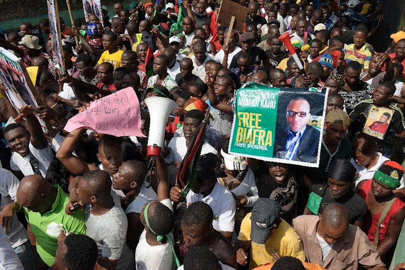 Pro-Biafra supporters hold a poster of jailed activist Nnamdi Kanu during a protest in Aba, southeastern Nigeria on November 18, 2015, calling for his release from prison (AFP Photo/Pius Utomi Ekpei)