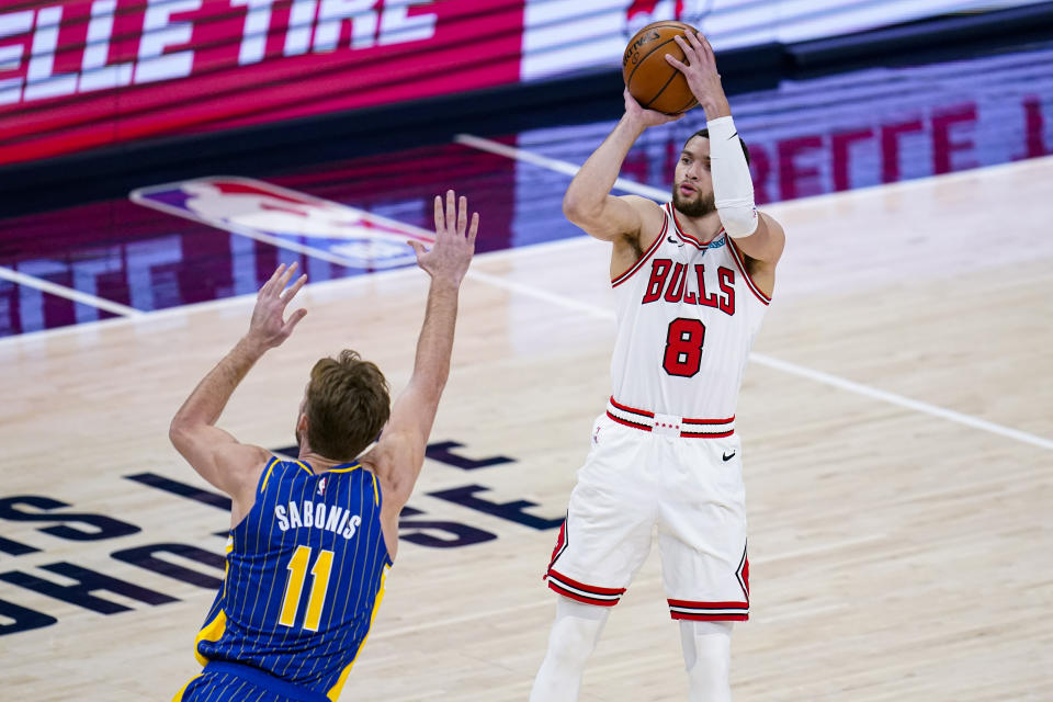 Chicago Bulls guard Zach LaVine (8) shoots over Indiana Pacers forward Domantas Sabonis (11) during the first half of an NBA basketball game in Indianapolis, Monday, Feb. 15, 2021. (AP Photo/Michael Conroy)