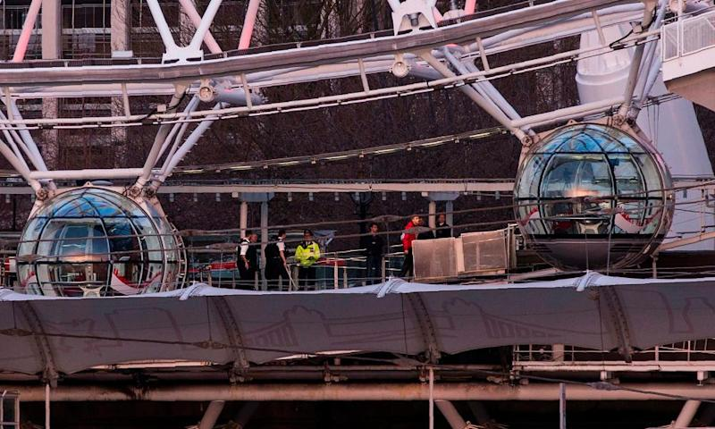 Tourists being evacuated from London Eye pods by police.