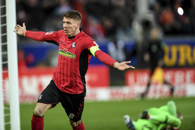 Freiburg's Mike Frantz celebrates after scoring his side's third goal during the German Bundesliga soccer match between SC Freiburg and RB Leipzig in Freiburg, southern Germany, Saturday, Dec. 8, 2018. (Patrick Seeger/dpa via AP)